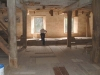 db_man-studying-grist-stones-mill-interior2